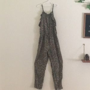 A long jump suit with off the shoulder sleeves